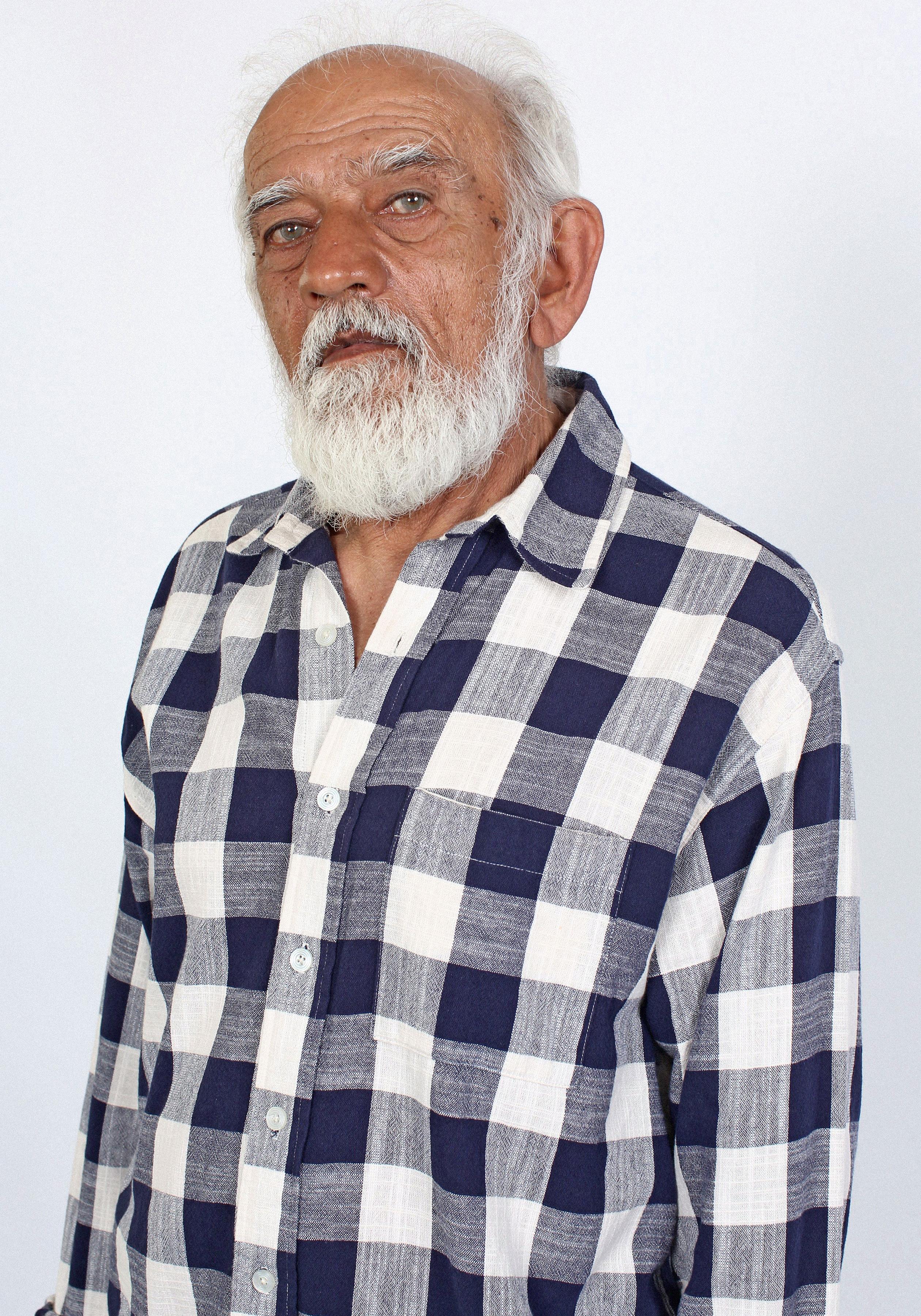 Detail of Prakash in Plaid Button Down